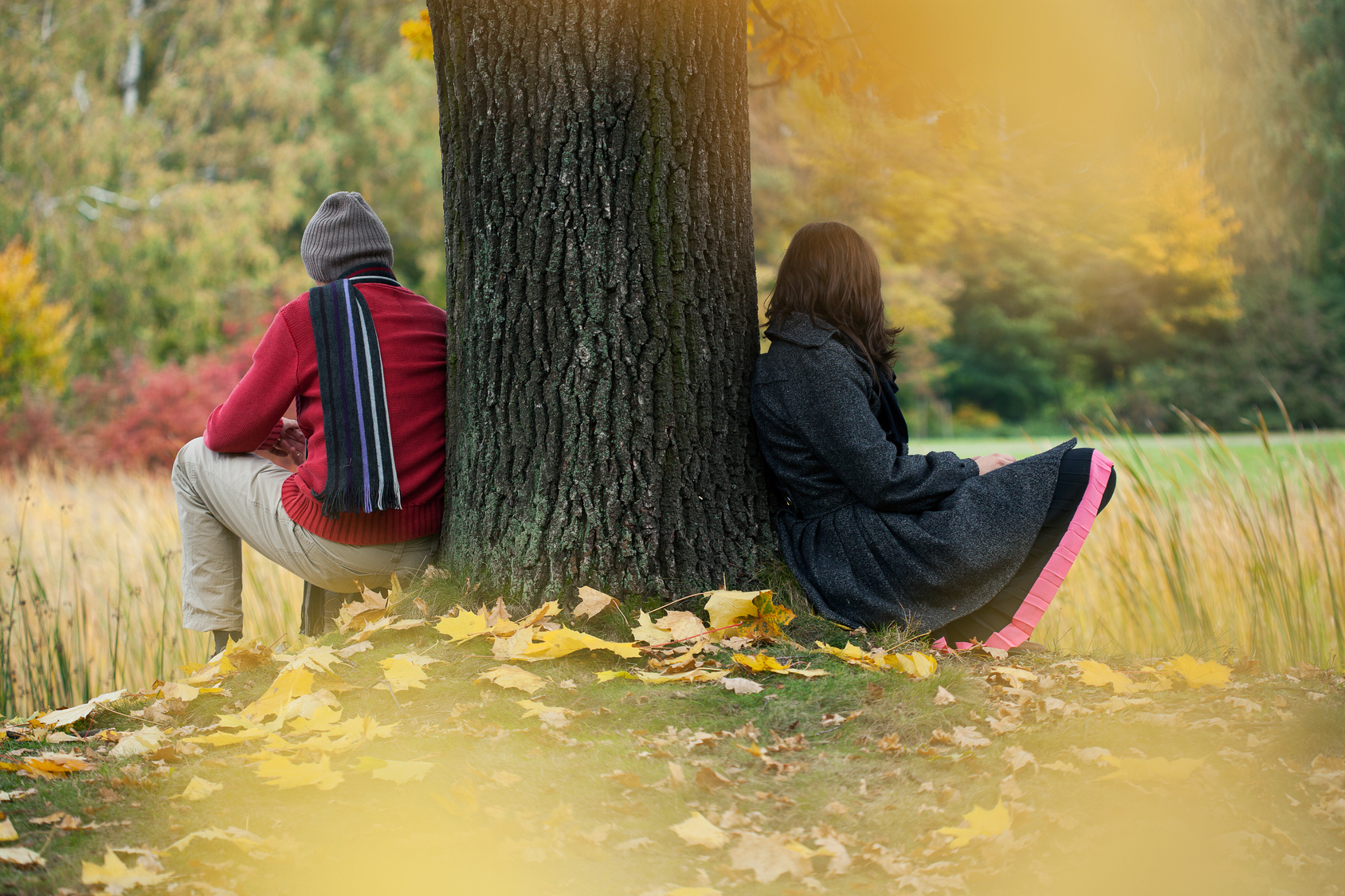 Man and woman contemplationg in the autumn park