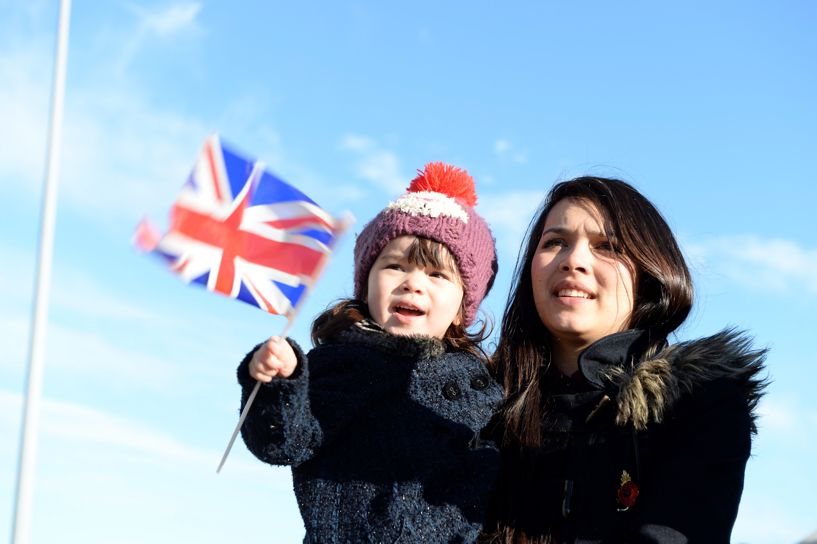 Summer Sabin (Left) spots her father on HMS Defender with her mum Sarah Sabin as HMS Defender returns home to Portsmouth.  A ROYAL Navy Destroyer was deployed to Scottish waters at short notice prior to Christmas in order to intercept and escort a number of Russian warships during their passage past the coast of the UK.  HMS Defender, one of the UK's newest and most powerful T45 Destroyers, began her 700 mile journey from Portsmouth to the North East of Scotland on 19th December in her role as Fleet Ready Escort. Trained and prepared as the Royal Navy's high readiness warship, Defender was standing by over the Christmas and New Year period to respond to a wide range of short notice tasking, from search and rescue duties to maritime security patrols such as this.  Defender patrolled home waters in high sea states and storm force winds to welcome the Russian task group which comprised of 6 vessels, including a 65,000 tonne aircraft carrier.  Due to bad weather the Russian fleet anchored in the Moray Firth before heading down the East coast of the UK. As a sign of the friendship between the 2 navies, good will messages were exchanged between the Royal Navy and Russian ships on New Year's Eve. Consent held.