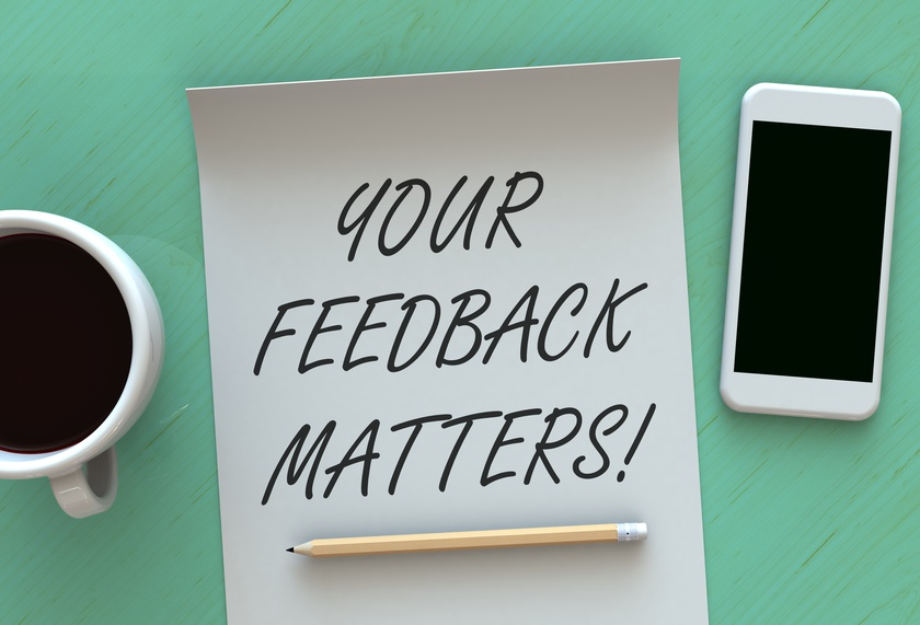 Your Feedback Matters, message on paper, smart phone and coffee on table