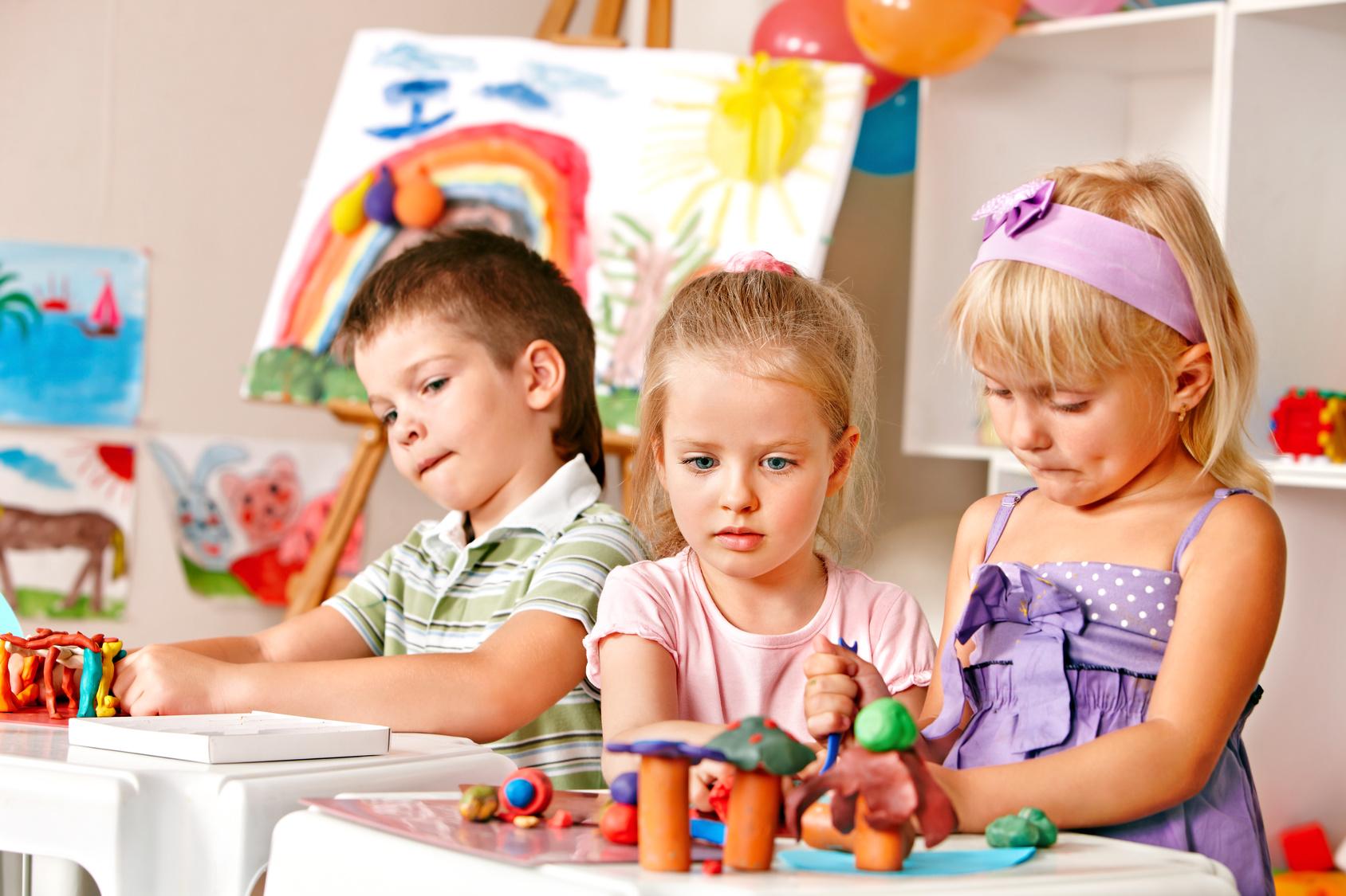 Group of children  in preschool thumb up.